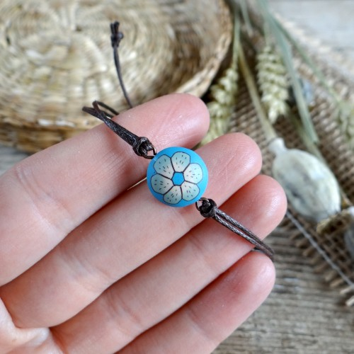 Light Blue Stackable String Bracelet with a Flower Design