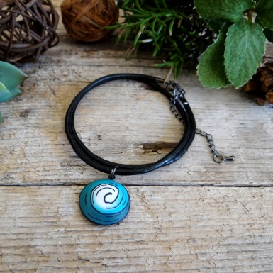 Turquoise Spiral Pendant on a Black Leather Necklace