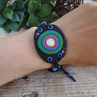 Large Black Statement Bracelet with a Colorful Spiral Pattern