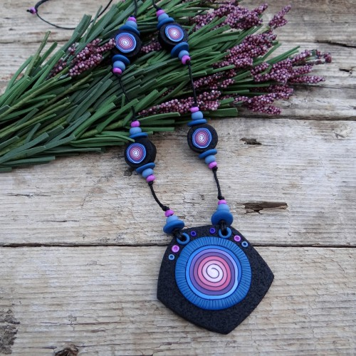 Long Black Statement Necklace with a Pink Spiral Pattern