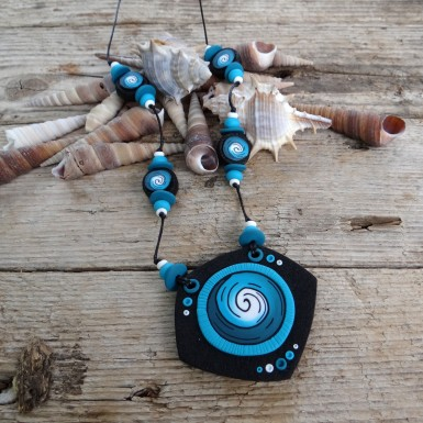 Long Black Statement Necklace with a Turquoise Spiral Pattern